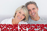 Composite image of cheerful couple in bed