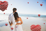 Composite image of content couple looking at the sea