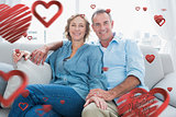 Composite image of middle aged couple relaxing on the couch