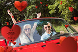 Composite image of mature couple in red cabriolet cheering at camera
