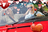 Composite image of happy mature couple in red cabriolet