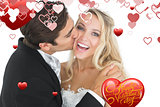 Composite image of handsome bridegroom kissing his wife on her cheek