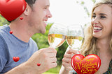 Composite image of cheerful couple toasting with white wine