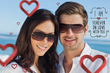 Composite image of smiling couple wearing sunglasses and looking at camera