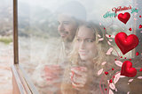 Composite image of thoughtful content couple with cups looking through window