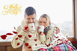 Composite image of loving couple in winter wear drinking coffee against window