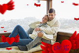 Composite image of couple in winter clothing sitting against cabin window