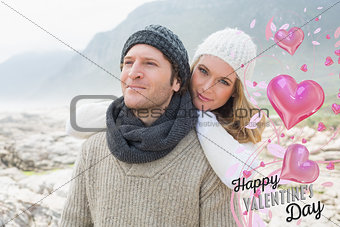 Composite image of romantic young couple together on a rocky landscape