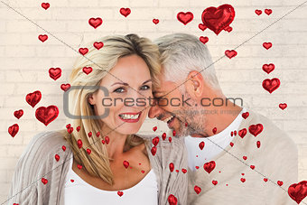 Composite image of happy couple laughing together woman looking at camera