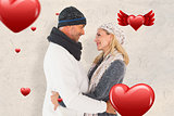 Composite image of happy couple in winter fashion embracing
