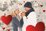 Composite image of couple in winter fashion embracing