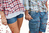 Composite image of couple in check shirts and denim holding hands