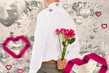 Composite image of man holding bouquet of roses behind back