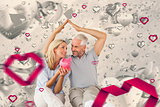 Composite image of happy couple sitting and sheltering piggy bank