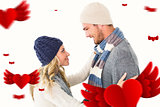 Composite image of attractive couple in winter fashion hugging