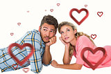 Composite image of attractive young couple lying and thinking