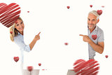 Composite image of happy couple holding and pointing to large poster