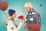 Composite image of attractive man in winter fashion offering roses to girlfriend
