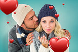 Composite image of attractive couple in winter fashion