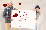 Composite image of attractive couple in winter fashion showing poster