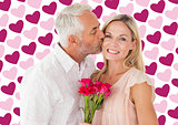 Composite image of affectionate man kissing his wife on the cheek with roses