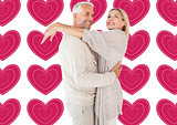 Composite image of happy couple standing and hugging