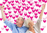 Composite image of happy mature couple with hands up