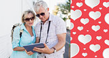 Composite image of happy tourist couple using tablet in the city