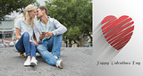 Composite image of hip young couple sitting on skateboard kissing
