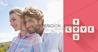 Composite image of smiling couple standing outside together