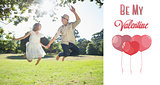 Composite image of cute couple jumping in the park together holding hands
