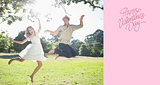 Composite image of cute couple jumping in the park together