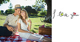 Composite image of cute couple drinking white wine on a picnic smiling at each other
