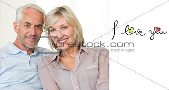Composite image of smiling mature couple sitting on sofa with arm around