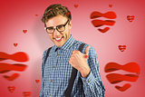 Composite image of geeky hipster showing thumbs up