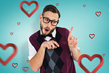 Composite image of geeky hipster in sweater vest pointing