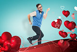 Composite image of geeky hipster dancing and smiling