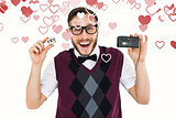 Composite image of geeky hipster holding a retro tape cassette player