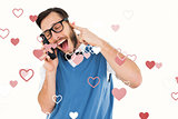 Composite image of geeky hipster talking on a retro cellphone