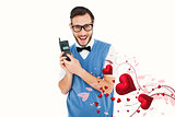 Composite image of geeky hipster holding a retro cellphone