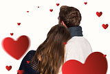 Composite image of close up rear view of romantic couple