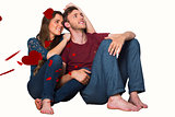 Composite image of young couple sitting on floor
