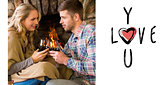 Composite image of couple toasting wineglasses in front of lit fireplace