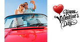 Composite image of smiling couple standing in red cabriolet taking picture