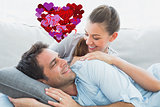 Composite image of cheerful couple relaxing on their sofa smiling at each other