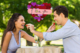 Composite image of couple feeding strawberries to each other at outdoor café
