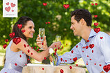 Composite image of couple with champagne flutes sitting at outdoor café
