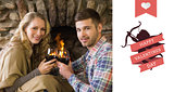 Composite image of romantic couple toasting wineglasses in front of lit fireplace