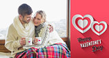 Composite image of loving couple in winter wear with cups against window