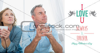 Composite image of thoughtful middle aged couple sitting on the couch having coffee